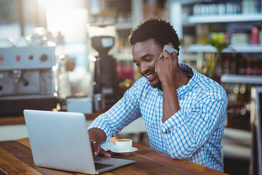 Man completing online banking transactions